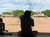 Pará State, Brazil. Aldeia Kikretum. Man making a basket in silhouette.