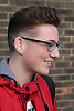 Teenage boy with glasses smiling