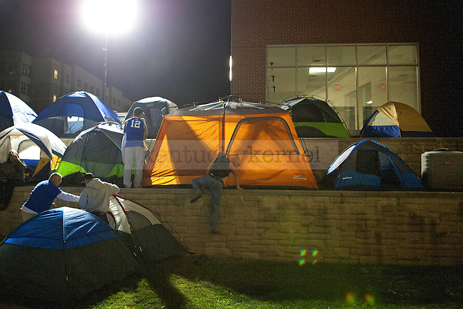 A UK fan climbs the wall to reserve his spot during Big Blue Madness campout in Lexington, Ky.,on Wednesday, September 17, 2014. Photo by Michael Reaves | Staff