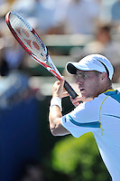 MELBOURNE, 15 JANUARY - Lleyton Hewitt (AUS) prepares to hit a forehand in the final of the 2011 AAMI Classic against Gael Monfils (FRA) at Kooyong Tennis Club in Melbourne, Australia. (Photo Sydney Low / syd-low.com)