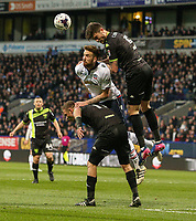 Bolton Wanderers' Mark Beevers battles in the air with Bury's Cameron Burgess and Tom Pope <br /> <br /> Photographer Alex Dodd/CameraSport<br /> <br /> The EFL Sky Bet League One - Bolton Wanderers v Bury - Tuesday 18th April 2017 - Macron Stadium - Bolton<br /> <br /> World Copyright &copy; 2017 CameraSport. All rights reserved. 43 Linden Ave. Countesthorpe. Leicester. England. LE8 5PG - Tel: +44 (0) 116 277 4147 - admin@camerasport.com - www.camerasport.com