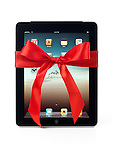 Apple iPad 3G tablet with a red gift bow tied around it isolated on white background