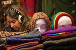 © Joel Goodman - 07973 332324 . 21 November 2013 . Manchester , UK . Scarf stall . Candid photos of the Christmas Markets in Manchester City Centre . Photo credit : Joel Goodman