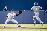 Michigan Wolverines first baseman Jimmy Kerr (15) stretches for a throw against the San Jose State Spartans on March 27, 2019 in Game 1 of the NCAA baseball doubleheader at Ray Fisher Stadium in Ann Arbor, Michigan. Michigan defeated San Jose State 1-0. (Andrew Woolley/Four Seam Images)