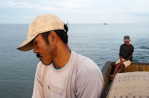 Sumatra, Aceh, tsunami survivors. Fishermen whos boats were destroyed by the tsunami return to their job with donated boats.