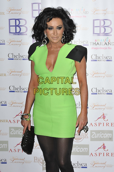 Nancy Dell'Olio.Arrivals at the Luxury and Lifestyle Awards, Porchester Hall, London, England..March 17th 2012.half length black green dress cleavage bows shoulder  .CAP/MAR.© Martin Harris/Capital Pictures.