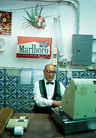 THe cashier at La Faena, one of the Cantinas from the old center of Mexico City. 5-14-04