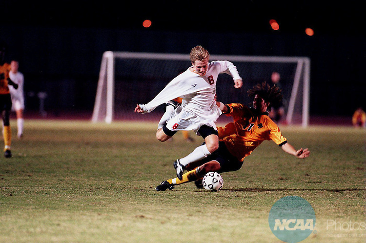 Caption: The University of Tampa's Rene Kronvold (#8) leaps over Oakland University's Andy Kalmbach (#11) at the NCAA Division II Men's Soccer Championship December 2, 1994, in Tampa, Florida. Tampa defeated Oakland University 3 to 0. Rick Runion/NCAA Photos.