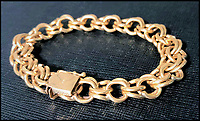 BNPS.co.uk (01202 558833)<br /> Pic:  Omega/BNPS<br /> <br /> A gold bracelet worn by Elvis, estimated at &pound;10,000.<br /> <br /> A glistening collection of blingy jewelry that belonged to Elvis Presley in the 1970s has emerged for sale for &pound;30,000.<br /> <br /> Consisting of two rings and a bracelet, the ensemble was owned Elvis at the height of his fame and are typical of the outlandish style he favoured at the time.<br /> <br /> The pieces all come from an esteemed memorabilia collector, who bought them from the famous Elvis-A-Rama museum in Paradise, Nevada.