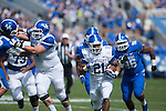 Running back Josh Clemons (21) sprints down the field during the Blue/White Spring Game in Lexington, Ky., on Saturday, April 26, 2014. Blue defeated White 38-14. Photo by Adam Pennavaria | Staff