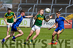 Kerry's Dylan Casey and Roscommon's Peter Gilhooley and Andrew Lyons  in action during the Kerry V Roscommon U17 match at Cusack Park Ennis on Saturday. Photograph by Eamon Ward