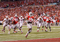 Ohio State Buckeyes running back Ezekiel Elliott (15) trots into the end zone in the second quarter of the Big Ten Championship game at Lucas Oil Stadium in Indianapolis on Saturday, December 6, 2014. (Columbus Dispatch photo by Jonathan Quilter)