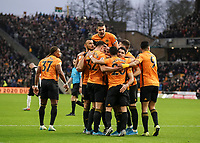 Wolverhampton Wanderers' Leander Dendoncker celebrates scoring his side's equalising  goal with team-mates Raul Jimenez Joao Moutinho Romain Saiss Pedro Neto and Conor Coady  to make the score 1-1 in the 14th minute<br /> Photographer Lee Parker/CameraSport<br /> <br /> The Premier League - Wolverhampton Wanderers v Newcastle United - Saturday 11th January 2020 - Molineux - Wolverhampton<br /> <br /> World Copyright © 2020 CameraSport. All rights reserved. 43 Linden Ave. Countesthorpe. Leicester. England. LE8 5PG - Tel: +44 (0) 116 277 4147 - admin@camerasport.com - www.camerasport.com