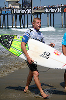 Australian Mick Fanning leaves the water after being defeated by Huntington Beach local Brett Simpson during the final. 2009 WQS 6 Star US Open of Surfing in Huntington Beach, California on Sunday July 26, 2009. ..