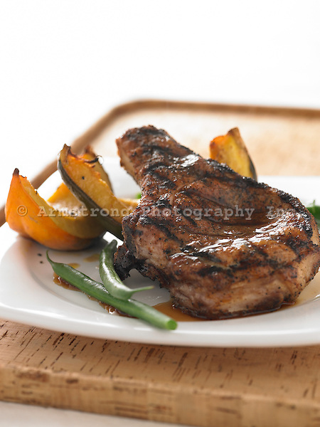 Grilled pork chop with acorn squash, green beans