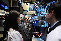 Peter Holland  talks with U.S. women national team midfielder Carli Lloyd and former U.S. Men's National Team star Jeff Agoos on the trading floor of the NYSE during the centennial celebration of U. S. Soccer at the New York Stock Exchange in New York, NY, on April 02, 2013.
