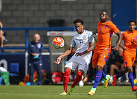Chris Willock (Arsenal) of England U19 passes the ball under pressure from Sherel Floranus (Sparta Rotterdam) of Holland during the International match between England U19 and Netherlands U19 at New Bucks Head, Telford, England on 1 September 2016. Photo by Andy Rowland.