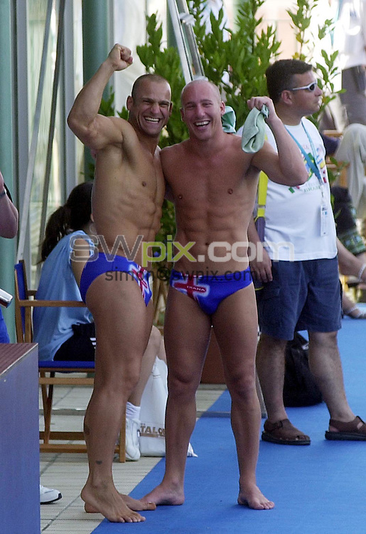 Pix: Matthew Lewis/SWpix.com. Diving. 10th Fina World Championships 2003, Barcelona. 15/07/2003...COPYRIGHT PICTURE>>SIMON WILKINSON>>01943 436649>>..Great Britain's Tony Ally and Mark Shipman celebrate, after they have qualified for the 2004 Olympics in Athens, Greece.