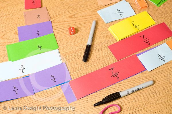 Education Elementary School grade 4 mathematics paper cut into lengths representing fractions still life horizontal