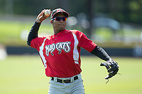 Carlos Franco (10) of the Carolina Mudcats warms up in the outfield prior to the game against the Winston-Salem Dash at BB&T Ballpark on April 22, 2015 in Winston-Salem, North Carolina.  The Dash defeated the Mudcats 4-2..  (Brian Westerholt/Four Seam Images)