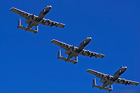 "A-10 ""Warthogs"" fly over the track at the end of the National Anthem."