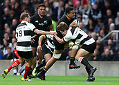 4th November 2017, Twickenham Stadium, Twickenham, England; Autumn International Rugby, Barbarians versus New Zealand; Vaea Fifita of New Zealand is challenged by Kwagga Smith and Willie Britz of Barbarians