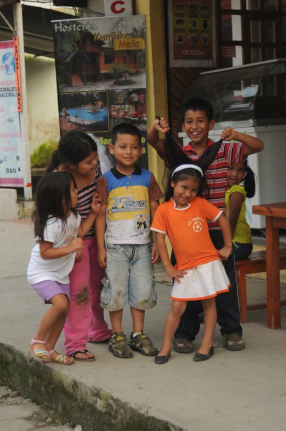 Children on main street in the small village of Mindo, Ecuador
