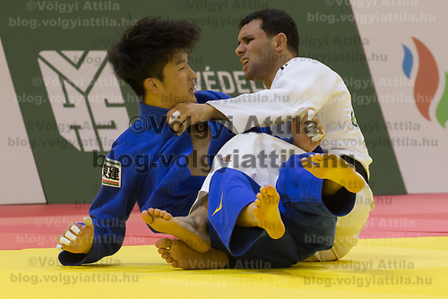 Kenzo Tagawa (L) of Japan and Mohamed Abdelmawgoud (R) of Egypt fight during the Men -66 kg category at the Judo Grand Prix Budapest 2018 international judo tournament held in Budapest, Hungary on Aug. 10, 2018. ATTILA VOLGYI