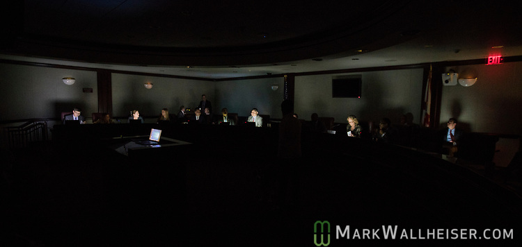 Senators are lighted only by their laptops when the lights went out momentarily in the Mallory Horne Committee Room during the Florida Senate Committee on Criminal Justice meeting at the Florida Capitol in Tallahassee Florida March 13, 2017.