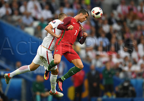30.06.2016. Marseille, France.  Artur Jedrzejczyk (L) of Poland and Cristiano Ronaldo of Portugal vie for the ball during the UEFA EURO 2016 quarter final soccer match between Poland and Portugal at the Stade Velodrome in Marseille, France, 30 June 2016.