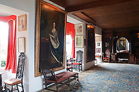 View down the portrait-lined Big Hall with a carpet designed by William Morris who was a reguler guest at Hilles