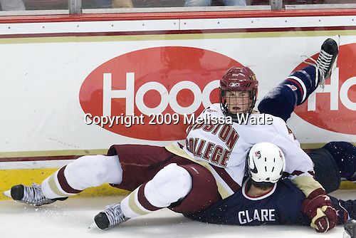 Brian Dumoulin (BC - 2), Kevin Clare (US - 4) - The Boston College Eagles defeated USA Hockey's National Team Development Program's Under 18 team 6-3 on Friday, October 9, 2009 at Conte Forum in Chestnut Hill, Massachusetts.