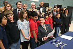 Gov. Brian Sandoval talks with a group of fifth-graders before signing the school bond bill into law at a local elementary school in Carson City, Nev., on Wednesday, March 4, 2015. <br /> Photo by Cathleen Allison