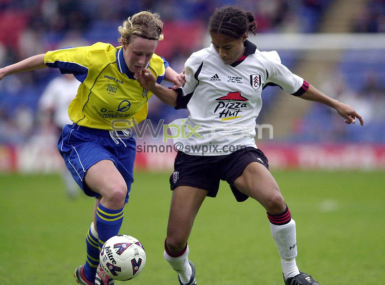 Pix: Matthew Lewis/SWpix.com. Soccer. The AXA F.A. Womens Cup Final. Fulham v Doncaster Belles. 06/05/2002...COPYWRIGHT PICTURE>>SIMON WILKINSON>>01943 436649>>..Fulham's Rachel Yankey and Doncaster's Claire Utley challenge for the ball.