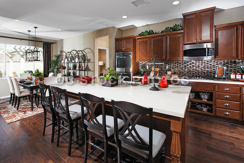 Kitchen Stock Photo with Hard Wood Floors and White Honed Granite