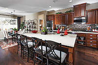 Kitchen Stock Photo with Hard Wood Floors and White Honed Granite