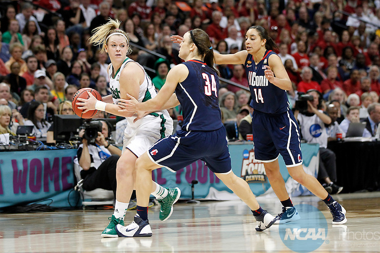 01 APRIL 2012:  Brittany Mallory (22) of the University of Notre Dame looks for an open teammate against Kelly Faris (34) and Bria Hartley (14) of the University of Connecticut during the Division I Women's Final Four Semifinals at the Pepsi Center in Denver, CO.  Notre Dame defeated UCONN 83-75 to advance to the national championship game.  Jamie Schwaberow/NCAA Photos