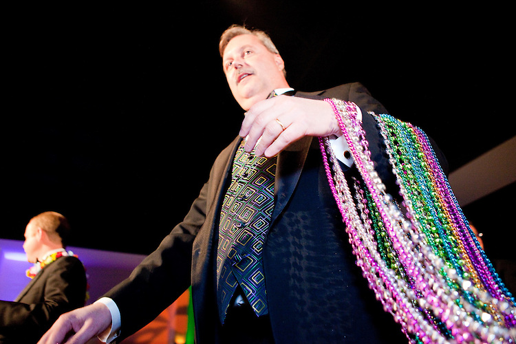Officers enter the ballroom, throwing beads, at the Krewe of Orpheus' ball, held at the Castine Center in Mandeville, Louisiana (a suburb of New Orleans) on February 6, 2010.