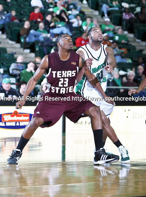 Texas State Bobcats forward Cameron Johnson (23) blocks out North Texas Mean Green guard Shannon Shorter (21) after a free throw in the game between the Texas State Bobcats and the University of North Texas Mean Green at the North Texas Coliseum,the Super Pit, in Denton, Texas. UNT defeated Texas State 85 to 62