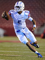 STAFF PHOTO ANDY SHUPE - Midland Christian quarterback Gary Powell carries the ball through the Highland on his way to the end zone during the first half of play Monday, Sept. 1, 2014, at Razorback Stadium in Fayetteville.