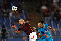 Calcio, Champions League, Gruppo E: Roma vs Barcellona. Roma, stadio Olimpico, 16 settembre 2015.<br /> Roma's Radja Nainggolan, left, and FC Barcelona's Sergio Busquets fight for the ball during a Champions League, Group E football match between Roma and FC Barcelona, at Rome's Olympic stadium, 16 September 2015.<br /> UPDATE IMAGES PRESS/Riccardo De Luca