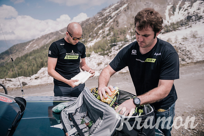 prepping bidons with foil & gels up the gravel roads of the Colle delle Finestre <br /> <br /> stage 19: Venaria Reale - Bardonecchia (184km)<br /> 101th Giro d'Italia 2018
