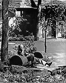 United States President Jimmy Carter relaxed in a cut-out log, which serves as a bench outside Aspen Lodge, at Camp David, the presidential retreat near Thurmont, Maryland, as he gathers his thoughts for the summit talks with Prime Minister Menachem Begin of Israel (not pictured) and President Anwar Sadat of Egypt (not pictured) on September 9, 1978.Credit: White House via CNP