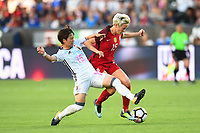Carson, CA - Thursday August 03, 2017: Yuka Momiki, Megan Rapinoe during a 2017 Tournament of Nations match between the women's national teams of the United States (USA) and Japan (JPN) at the StubHub Center.