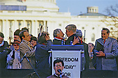 "Former Soviet Refusenik Vladimir Slepak hugs United States Representative Jack Kemp (Republican of New York) at the ""Campaign to the Summit"", a march on Washington, D.C. supporting freedom for Jews living in the Soviet Union, on Sunday, December 6, 1987.  200,000 people marched to focus attention on the repression of Soviet Jewry, was scheduled a day before United States President Ronald Reagan and Soviet President Mikhail Gorbachev began a 2 day summit in Washington where they signed the Intermediate Range Nuclear Forces (INF) Treaty.  From left to right: unidentified woman, Rabbi David Saperstein, unidentified woman, Vladimir Slepak, Jack Kemp, Morris Abram, partially obscured behind Kemp, and US Senator Bob Dole (Republican of Kansas).<br /> Credit: Ron Sachs / CNP"