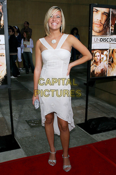 "KRISTIN CAVALLERI.Lions Gate World Premiere of ""Undiscovered"" held at The Egyptian Theater, Hollywood, 23rd August 2005.full length white v strap dress silver clutch bag high heel sandals shoes hand hip.www.capitalpictures.com.sales@capitalpictures.com.© Capital Pictures."
