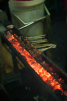Satay sticks cooking.<br />