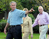 Washington, D.C. - June 5, 2008 -- United States President George W. Bush waves to a Member of Congress as he,first lady Laura Bush and Vice President Dick Cheney walk towards the stage at the Congressional Picnic on the South Lawn of The White House on Thursday, June 5, 2008.<br /> Credit: Ron Sachs / Pool via CNP