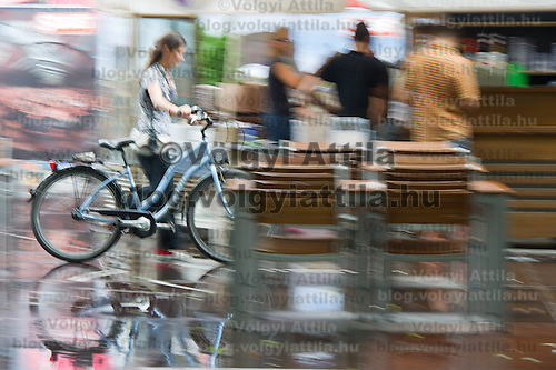 A participant with a bike walks on Sziget festival held in Budapest, Hungary on August 07, 2011. ATTILA VOLGYI