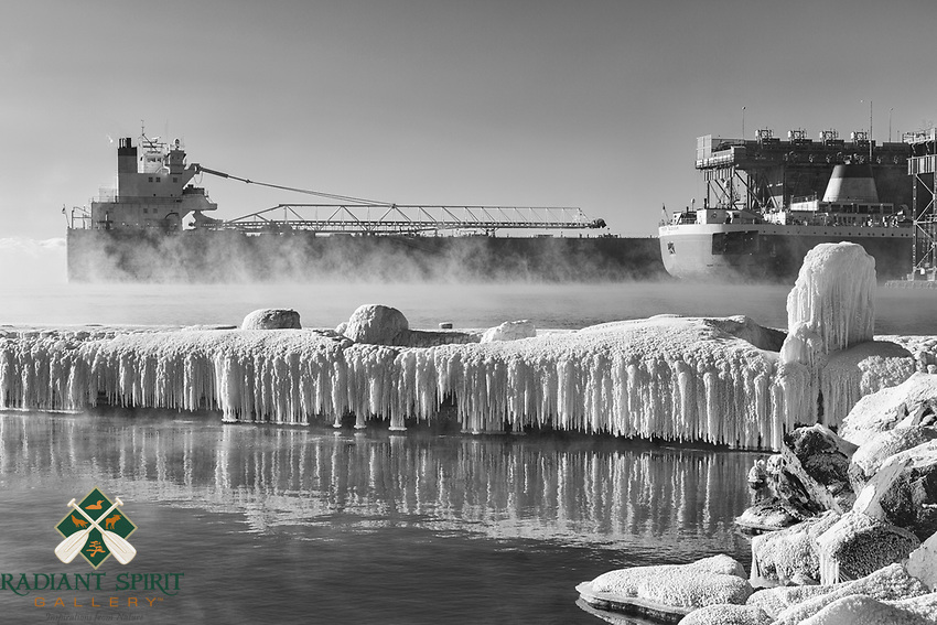 A shipping vessel arrives in Two Harbors, Minnesota on a -10°F (-23°C) morning on Lake Superior to load iron ore pellets.